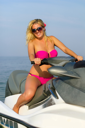 Cute smiling young blonde on a jet ski