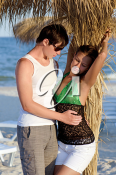 Portrait of a sensual young couple on the beach