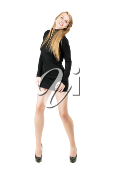 Young smiling blond woman in short black dress showing her nice legs. Isolated on white