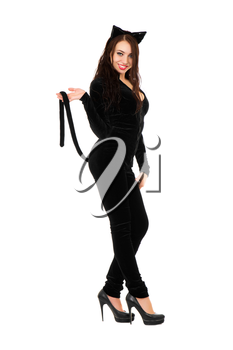 Sexy playful brunette dressed as black cat. Isolated on white