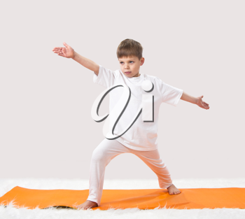 Royalty Free Photo of a Boy Doing Yoga