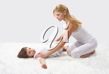 Royalty Free Photo of a Mother and Son Practicing Yoga