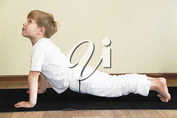 Royalty Free Photo of a Little Boy Practicing Yoga