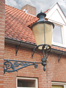Lantern on the facade of old  house