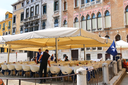VENICE, ITALY - MAY 06, 2014: Waiters serve tables in outdoor restaurant in Venice, Italy