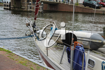 Anchored yacht in Spaarne river channel of Haarlem, the Netherlands