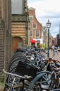Parked bicycles on the street in the historic center of Haarlem, the Netherlands