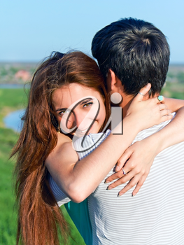 joy and sensuality in the relationship of the couple of young people outdoors