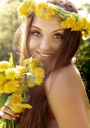 Attractive young summer girl with flowers