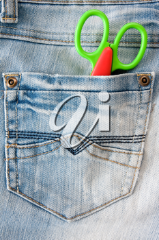 Royalty Free Photo of Scissors in a Pocket