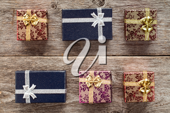 Six gift boxes on old wooden  background