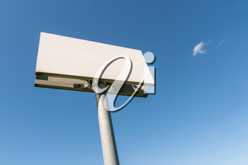 Blank billboard or signpost against blue sky, put your own text here