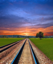 Railway in field on beautiful summer evening