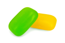 Two pieces of soap yellow and green isolated on a white background