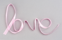 Royalty Free Photo of the Word Loved Spelled in Ribbon