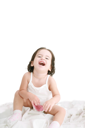 laughing little girl on her bed
