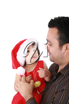 Father and daughter looking happy wearing santa Christmas hat. Focus on the baby