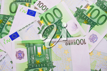 Many euro banknotes making european currency background