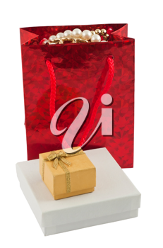 Royalty Free Photo of a Gift Bag with Jewelery and a Couple of Presents