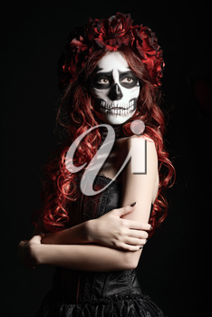 Portrait of a young woman with muertos makeup (sugar skull)