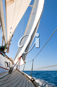 Royalty Free Photo of a Yacht Sailing the Sea