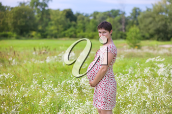 Royalty Free Photo of a Pregnant Woman in a Meadow