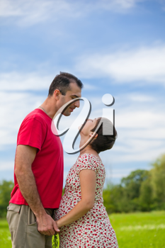 Royalty Free Photo of a Husband Looking at His Pregnant Wife