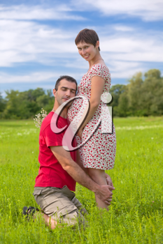 Royalty Free Photo of a Husband Hugging His Pregnant Wife