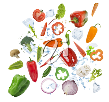 Colorful fresh vegetables with ice cubes isolated on white background