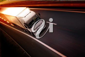 A white truck on highway - delivery concept