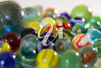 collection of marbles on white background
