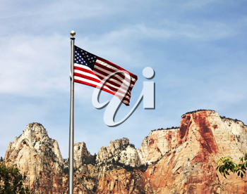 Royalty Free Photo of an American Flag and Mountains