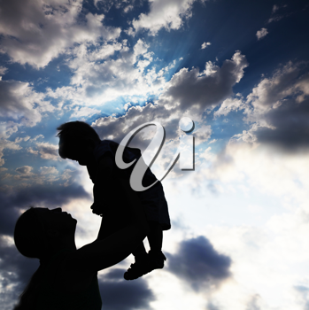 Royalty Free Photo of a Parent and Child Silhouette