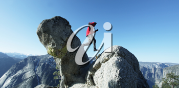 Royalty Free Photo of a Person Walking on Boulders in Yosemite