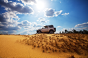 Royalty Free Photo of a Jeep in the Desert