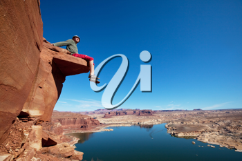 Royalty Free Photo of a Man on a Cliff