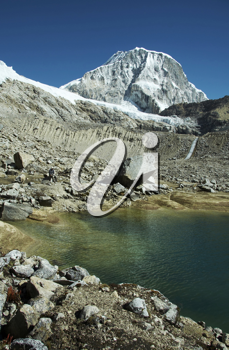 Royalty Free Photo of a Lake and Ranrapalka Peak in the Cordilleras Mountains