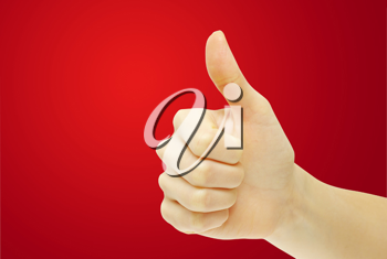 Royalty Free Photo of a Person Giving a Thumbs Up