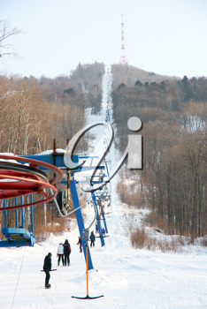 Skiers go on the lift on mountain in Primorski Territory Russia