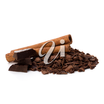 Crushed chocolate shavings pile and cinnamon sticks isolated on white background