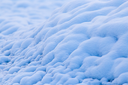 blue snow in the morning as a background