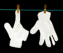 The glove is dried on a rope on a black background .