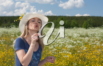 Royalty Free Photo of a Girl in a Field of Flowers