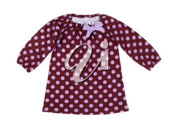 Brown baby dress with polka dots. Isolate on white.