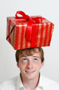 Royalty Free Photo of a Man With a Present on His Head