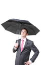 Royalty Free Photo of a Businessman Holding an Umbrella