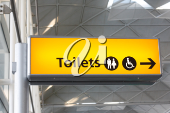 Royalty Free Photo of a Toilets Sign at an Airport