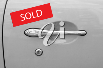 Royalty Free Photo of a Sold Car