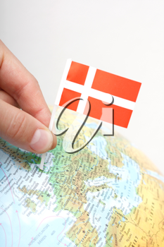 Royalty Free Photo of a Person Marking Denmark on a Globe