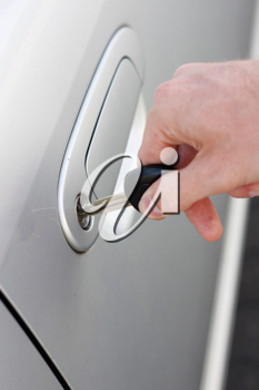 Royalty Free Photo of a Person Locking a Car Door